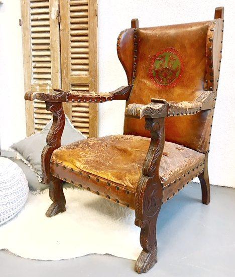 Antieke leren fauteuil